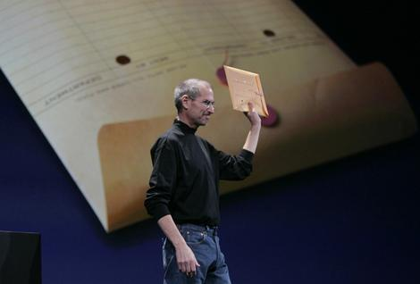 Apple CEO Steve Jobs holds an envelope containing the new MacBook Air during his keynote at the MacWorld Conference in San Francisco.